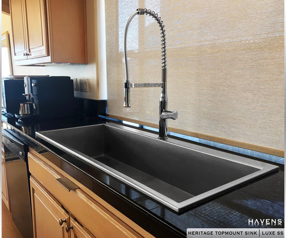 custom topmount stainless steel kitchen sink with a deck for the faucet