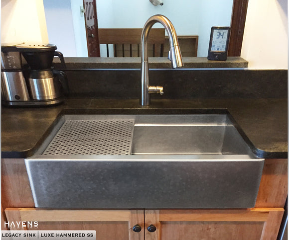 ... Hammered Stainless Steel Apron Sink With A Large Farm Sink Basin.