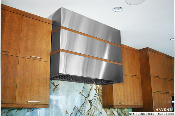 Stainless steel range hood installed in high end residential kitchen.