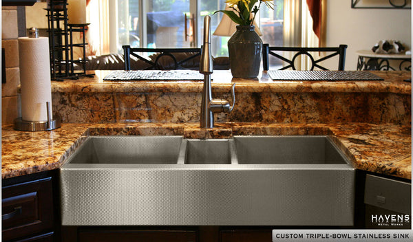Custom stainless steel sink installed in kitchen. The immaculate triple-bowl by Havens.