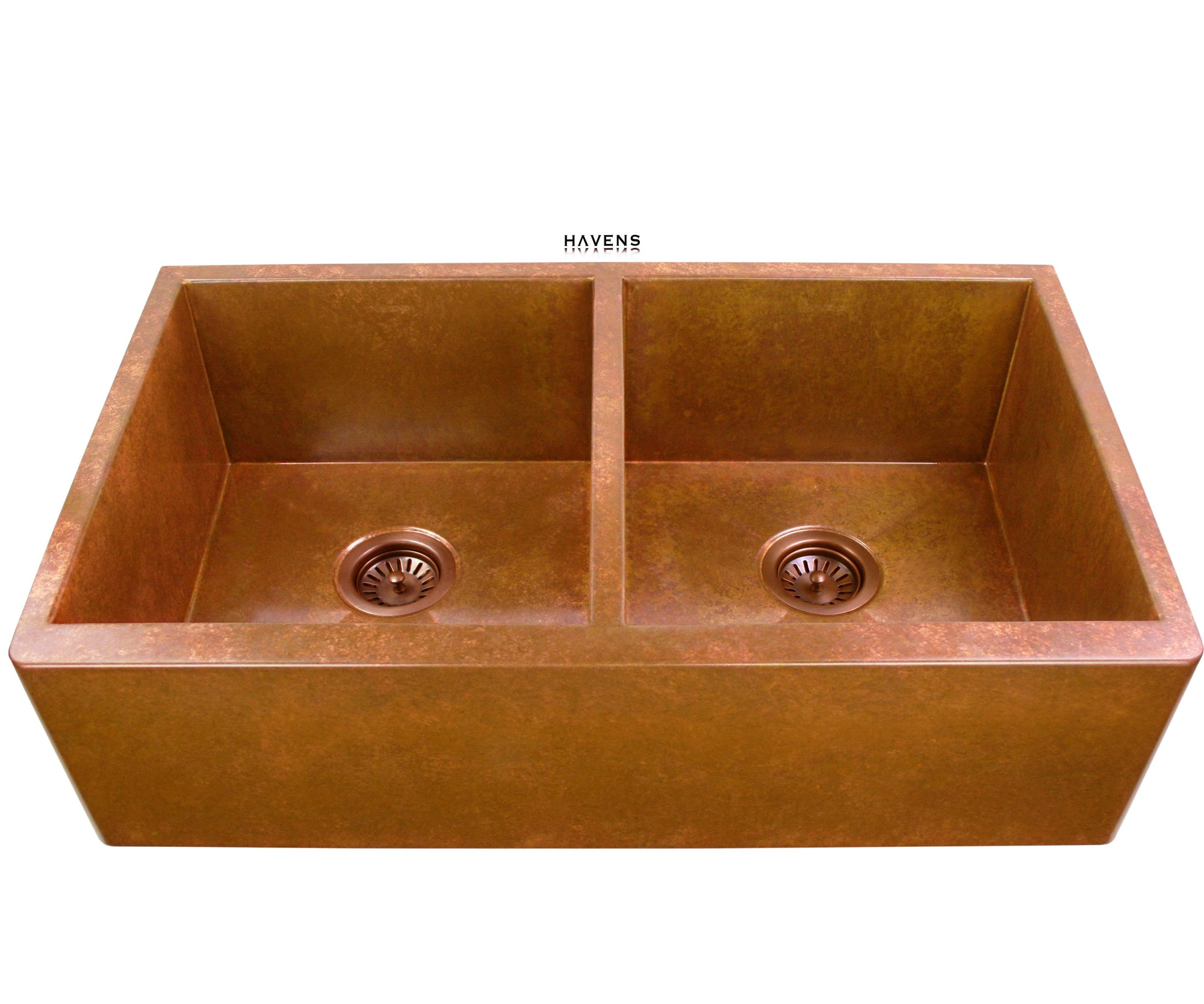 Double bowl copper farmhouse sink with two basins and a built in ledge for advanced utility.