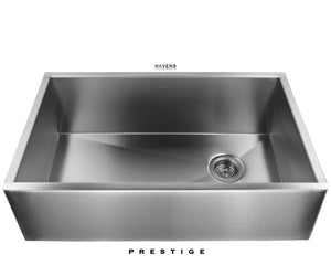 Textured stainless steel farmhouse kitchen sink with a right rear drain.