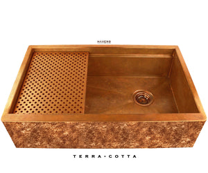 Legacy copper farmhouse sink with copper patina artwork on the apron.