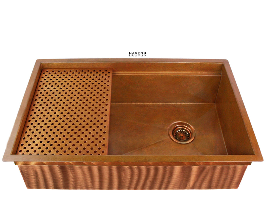 Undermount copper kitchen sink handcrafted from 14 gauge metal.