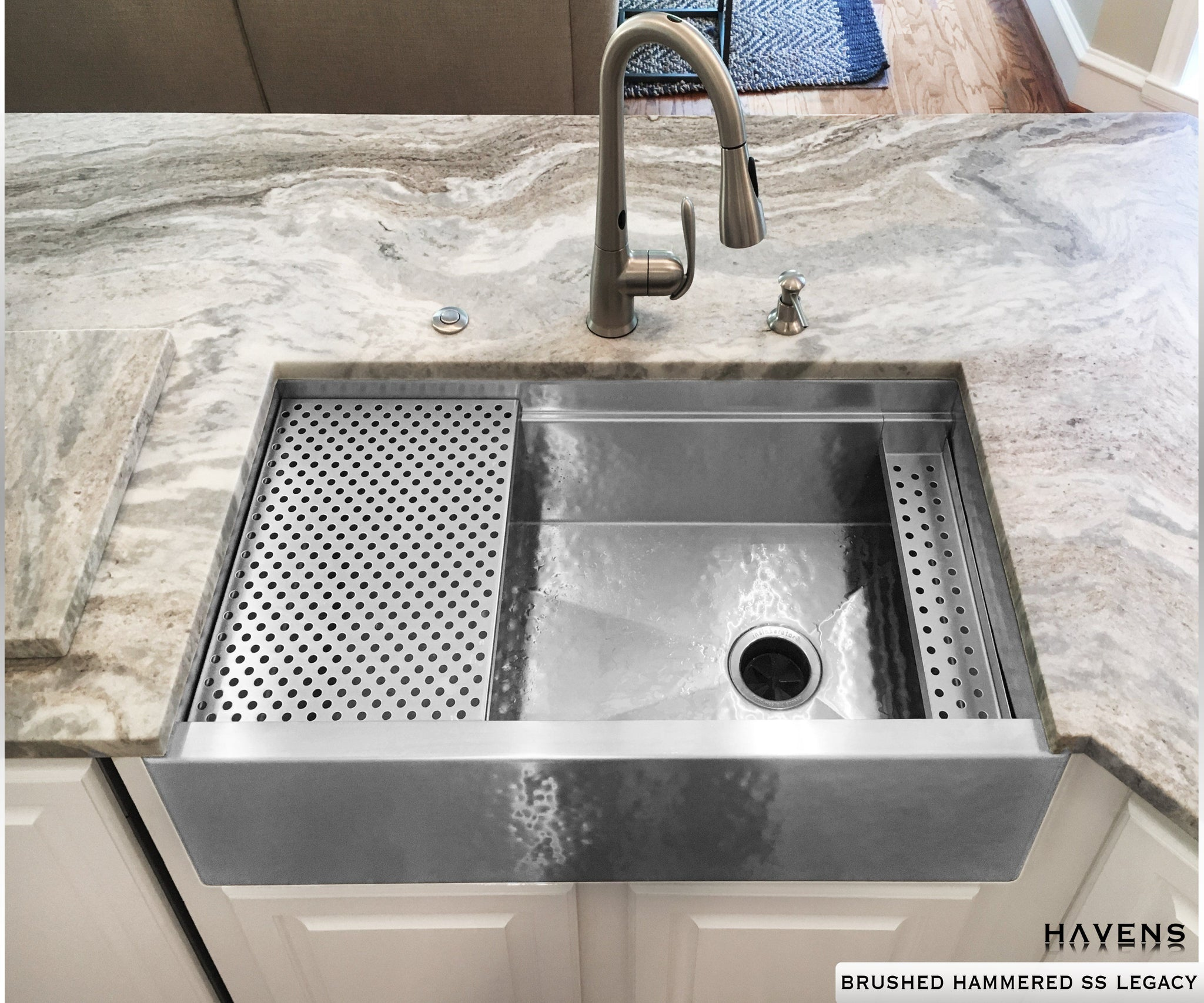 Hammered stainless steel farmhouse sink built from 16 gauge stainless steel. Brushed hammered finish on a workstation Legacy sink by Havens.