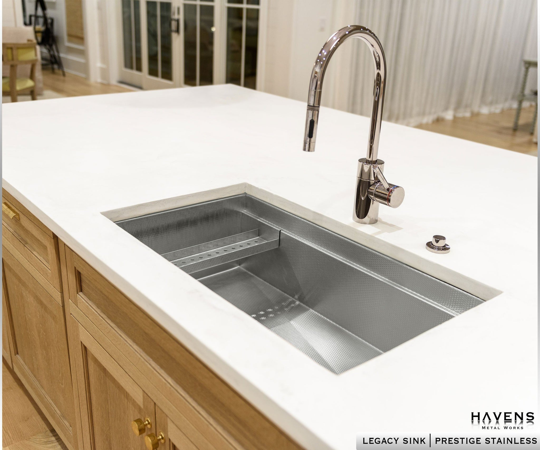 Undermount stainless steel kitchen sink made from 16 gauge steel. Textured stainless sink with a chrome faucet.
