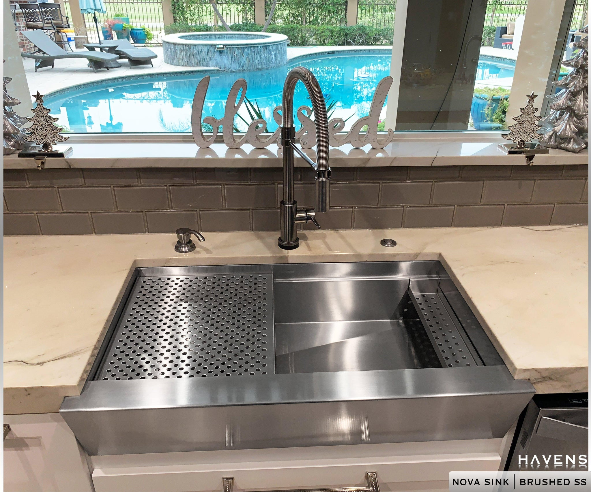 Nova Stainless Steel Sink with a workstation ledge
