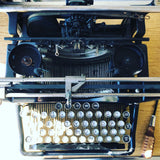Removing the Carriage on a Typewriter