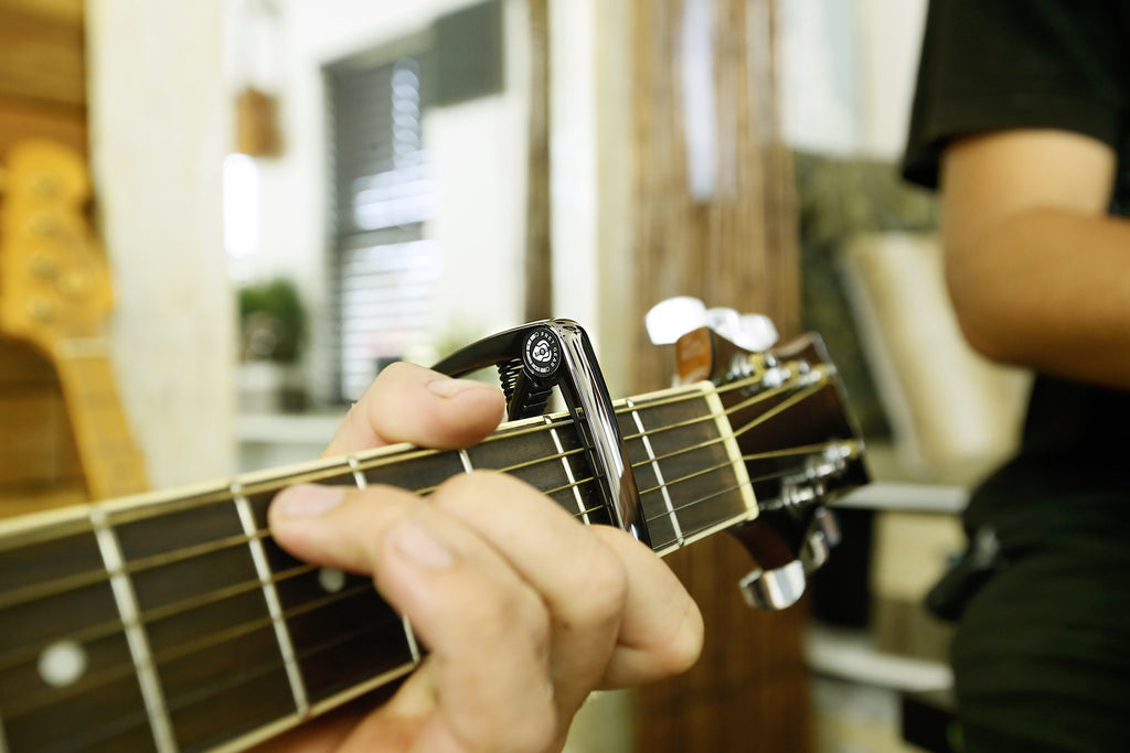 The Ultimate Capo Song List for Guitar Players