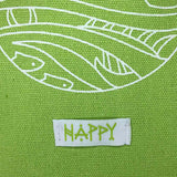 detail image of white sewn on tab that reads happy