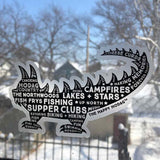 Black Hodag silhouette sticker with white words including 'amores, canoeing, pine trees, fishing, fish frys, up north, lakes+stars, campfires, supper clubs, kayaking, biking + hiking. Sticker shown on a window.