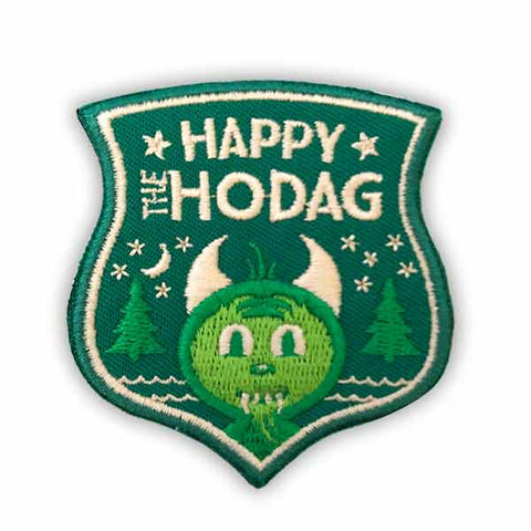 Forest green patch embroidered with lime green, Kelly green and eggshell white depicting happy the Hodag smiling with trees, water, stars and the moon behind him and the text at the top reads happy the Hodag