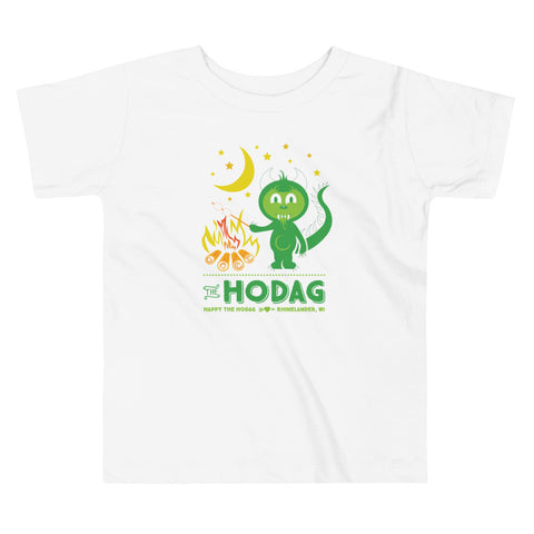 White toddler t-shirt featuring happy the Hodag roasting a marshmallow on a campfire under a cresent moon and stars. Text underneath says The Hodag, Happy the Hodag, Rhinelander, WI