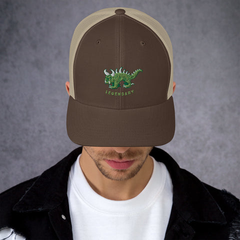 Brown and tan trucker cap with two tone green and white vintage embroidered Hodag with the word legendary underneath.