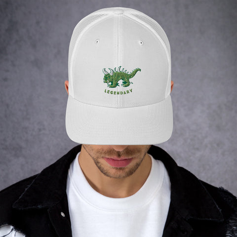 White trucker cap with two tone green and white vintage embroidered Hodag with the word legendary underneath.