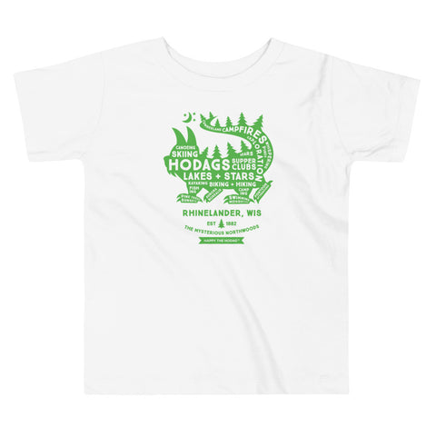 White toddler t-shirt with a green silhouette of a Hodag with the words 'hod's, supper clubs, lakes + stars, skiing, hiking, exploration, campfires, etc. in the silhouette in white . Text underneath reads Rhinelander Wis, Set 1882, The Mysterious Northwoods.