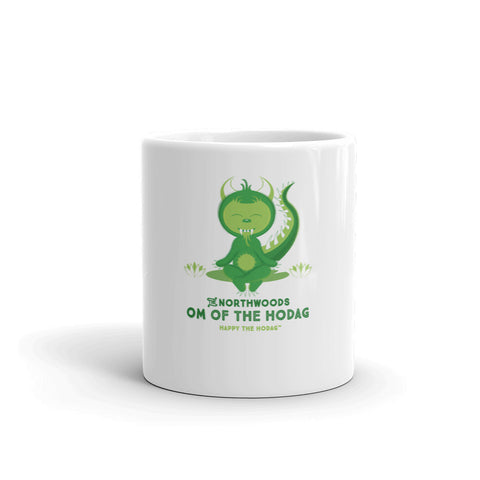 White porcelain coffee mug featuring happy the Hodag in a yoga pose on Lilly pad with the text 'the Northwoods, om of the Hodag, happy the hodag'