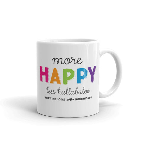 White porcelain coffee mug featuring colorful text and playful typography that reads 'more happy less hullabaloo, happy the Hodag, northwoords'