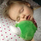 A little girl sleeping with her Happy the Hodag Plush Toy