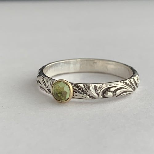 peridot birthstone silver and gold ring