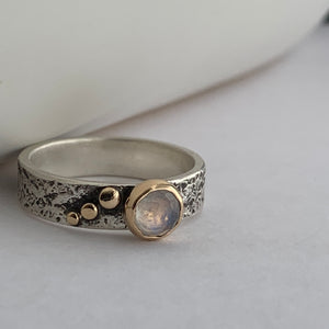 rainbow moonstone silver and gold ring with 3 gold dots on one side