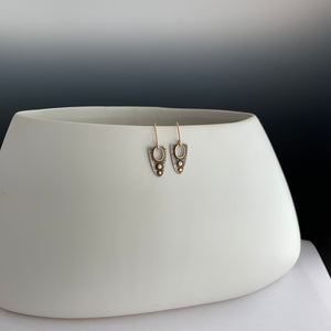 modern sterling and gold earrings with see-through opening framed in 14k gold