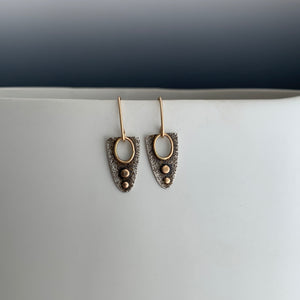 rough textured modern design earrings with gold accents and gold ear wires