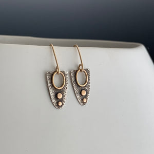 half eclipse shaped earrings in sterling silver with gold dots and accents and gold ear wires