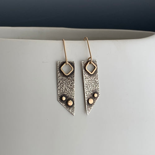 modern artistic dangle earrings in textured sterling silver with 14k gold framed cut-out and 2 gold dots with gold ear wires