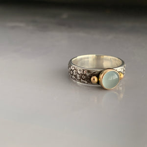 floral texture band ring with pale blue green aquamarine stone and gold accents