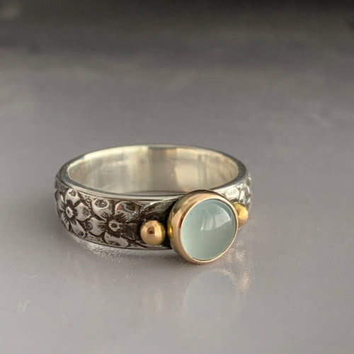 aquamarine statement ring with silver and gold