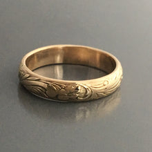floral texture embossed pattern on 14 karat gold wedding band or stacking ring