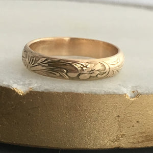 14 karat gold band with scrollwork design