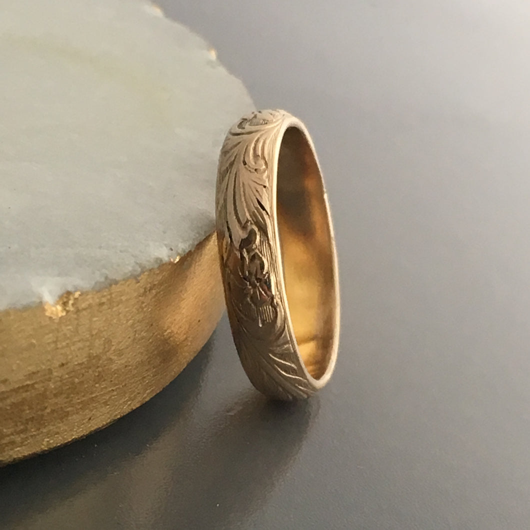 14k gold wedding band with embossed floral and leaves texture