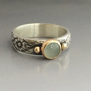 aquamarine ring in gold bezel setting on sterling embossed band