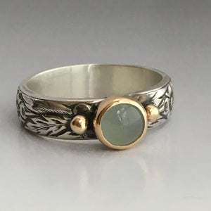 alternative wedding ring with aquamarine and silver and gold