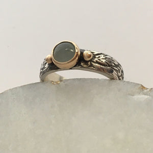 silver and gold ring with aquamarine in gold setting on floral band
