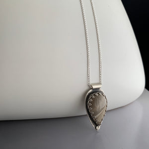 sterling silver pendant on sterling chain in teardrop shape