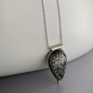 teardrop shaped pendant in sterling silver with silver chain