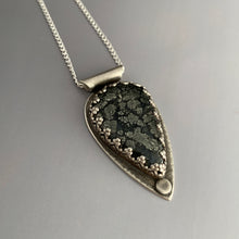 close-up photo of marcasite pendant with chain going through tube style bail