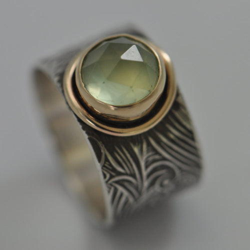 sterling textured band with gold bezel and gold frame surrounding setting and prehnite gemstone