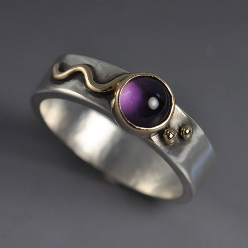 sterling ring with 14k gold accents and purple amethyst in gold setting