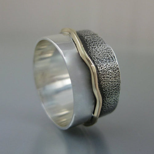 silver band with gold wave pattern running along the middle and texture on one side