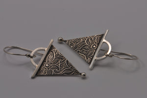 sterling silver dangle earrings with embossed pattern and modern design