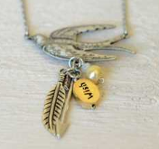 girl on fire necklace close up