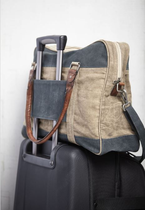 dash duffle bag on suitcase