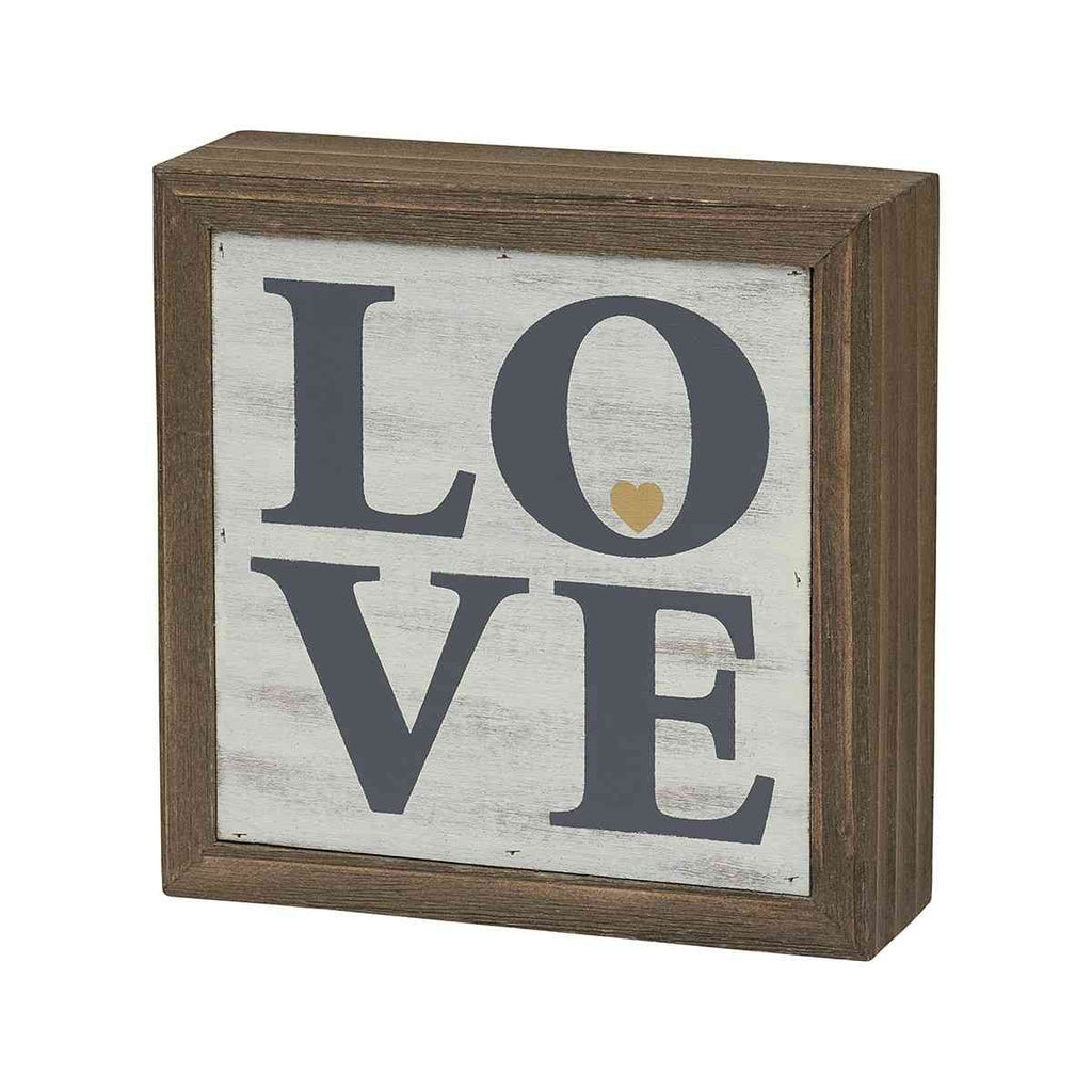 love painted sign on barn wood with heart