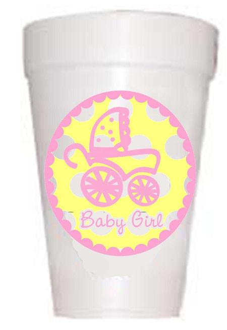 yellow polka dot circle with pink baby carriage on styrofoam cup