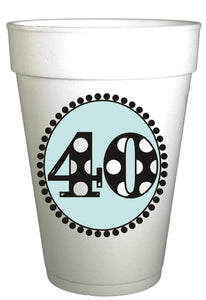 styrofoam cup with blue circle and black and white polka dot number 40