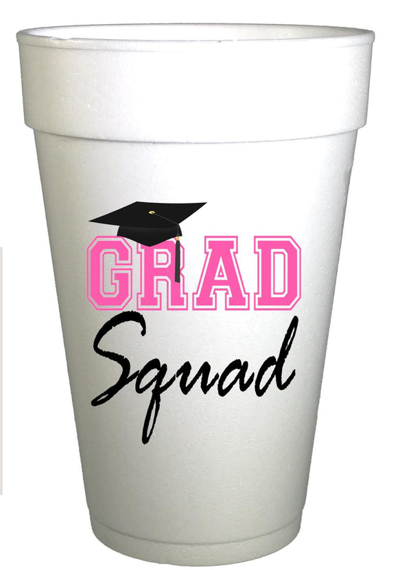 Styrofoam cups with black graduation cap and hot pink writing